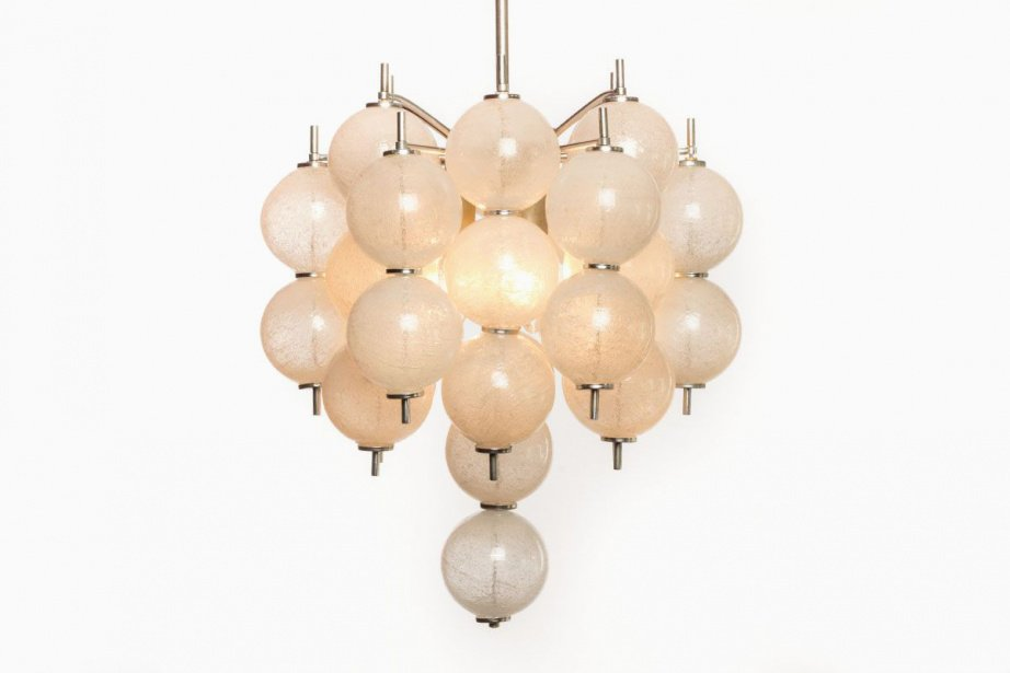 Discover the timeless elegance of vintage chandeliers crafted in Murano glass