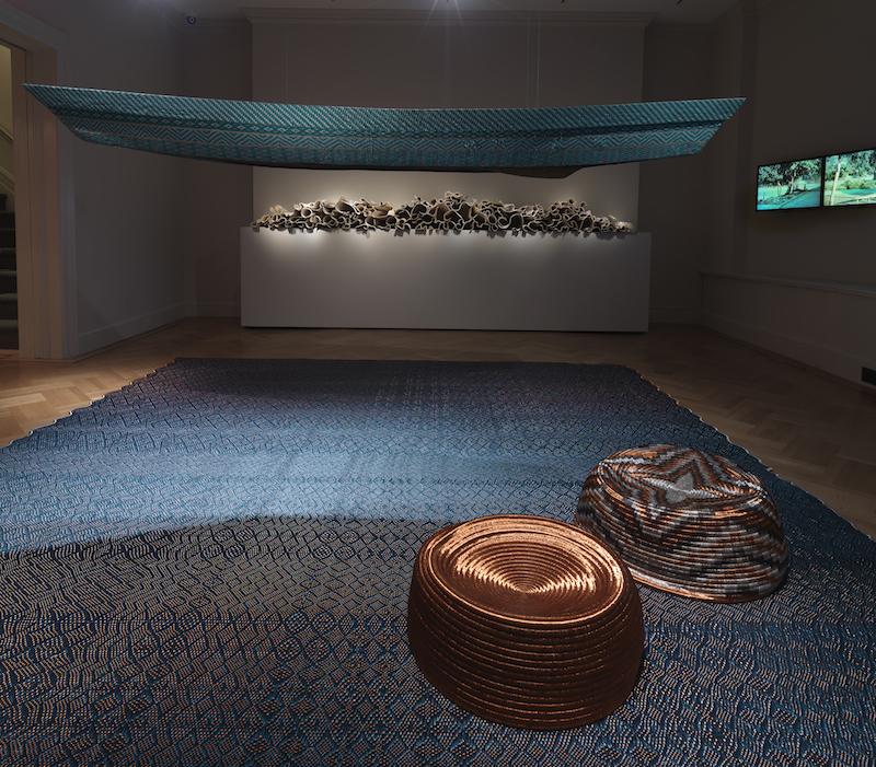 Hechizoo's woven canoe, stools, and carpet; Carol Young's Memoria ceramic installation; Nicolás Consuegra's El agua que tocas es la última que ha pasado y la primera que viene video