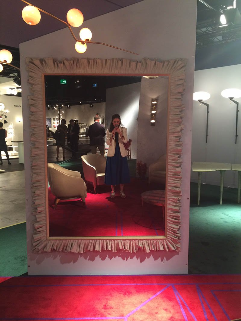 admiring a Gio Ponti Ruffled Mirror at Nilufar's booth