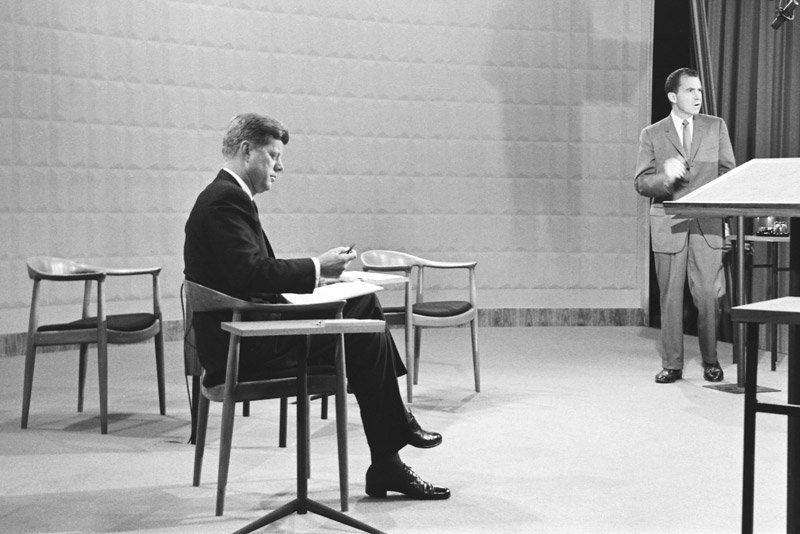 CHICAGO—September 26, 1960: NIXON-KENNEDY DEBATE. John F. Kennedy, seated at left, and Richard M. Nixon in advance of the first televised presidential debate. (Photo by CBS via Getty Images)