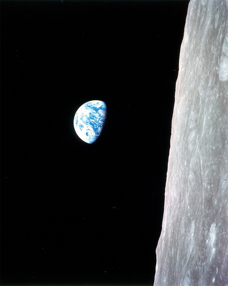 Earthrise, Apollo 8: This view of the rising Earth greeted Apollo 8's astronauts as they came from behind the Moon after the 4th nearside orbit. It is displayed here in its original orientation, though it is more commonly viewed with the lunar surface at the bottom of the photo.