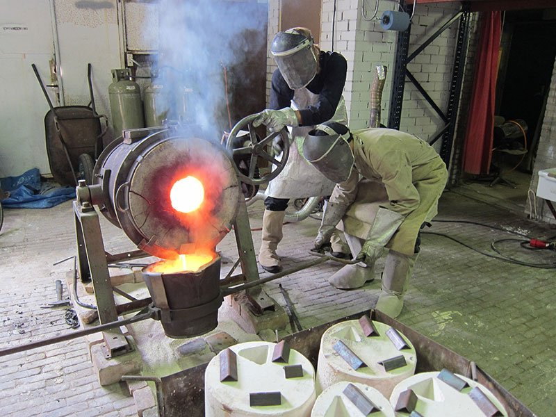 Pouring molten material in the workshop. Photo courtesy of Alexander Pelikan.