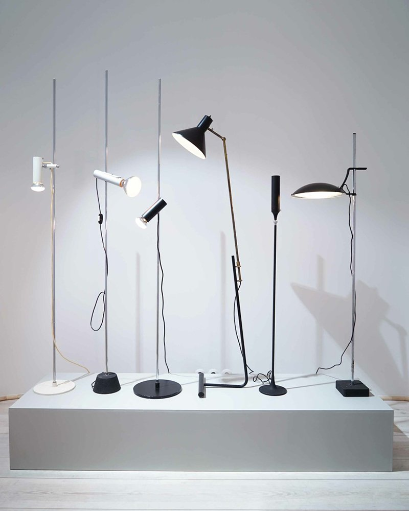 From left: Gino Sarfatti/Arteluce's Floor Lamp 1055 (1955), 1054 (1957), 1055 (1955), 1045 (1948), 1086 (1961), Standard Lamp (1958, private collection).
