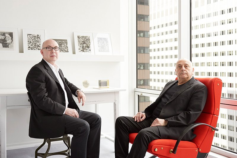 From left: Murray Moss and Franklin Getchell. Getchell sits on a red lounge chair by Osvaldo Borsani, made in 1950. Photo by Kyle Knodell, courtesy of Paddle 8.