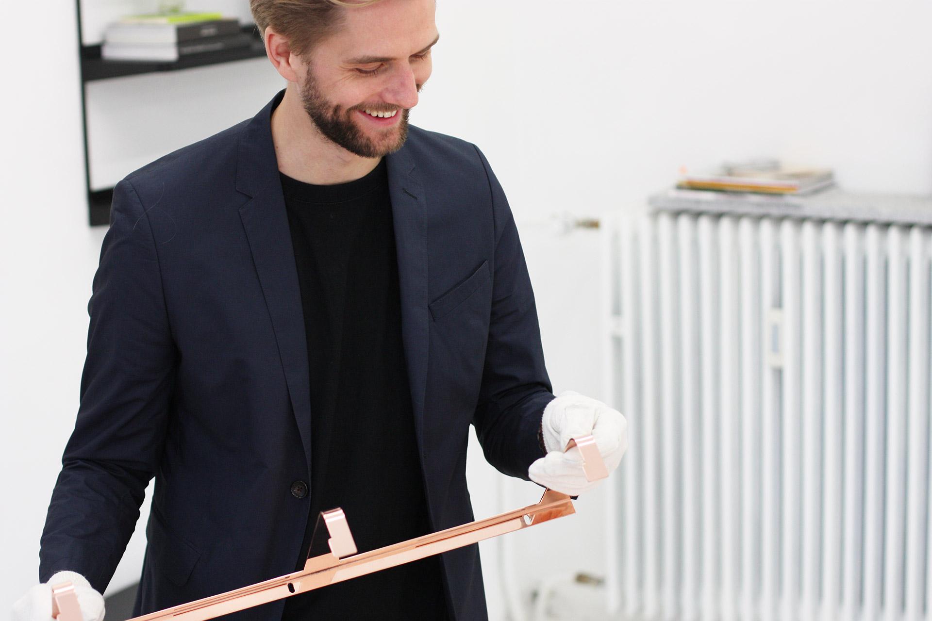 Sigurd Larson showing us the details of the Click Copper Shelf