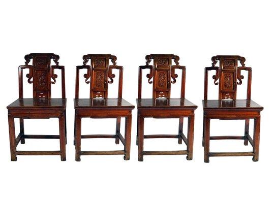 Sedie antiche in legno rosso intagliato, Cina, metà XIX secolo, set ...