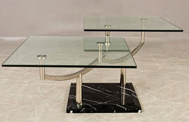 Two Tiered Glass Coffee Table With A Chrome Frame Stone Base For