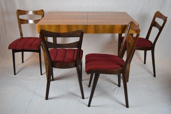 Mesa de comedor de teca con cuatro sillas, años 60