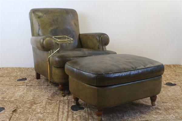 Club chair vintage in pelle verde con pouf e tavolino da fumo di ...