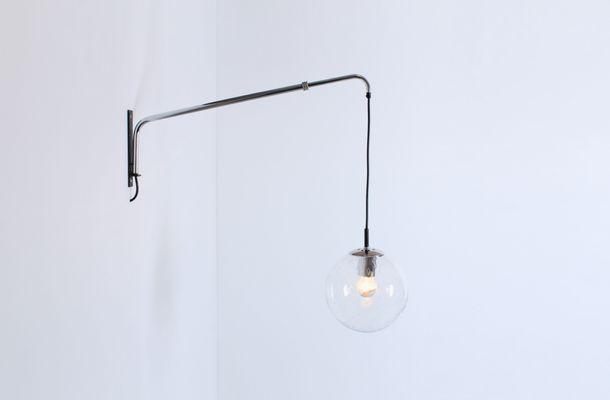 Lampada da parete vintage regolabile con sfera in vetro di raak in