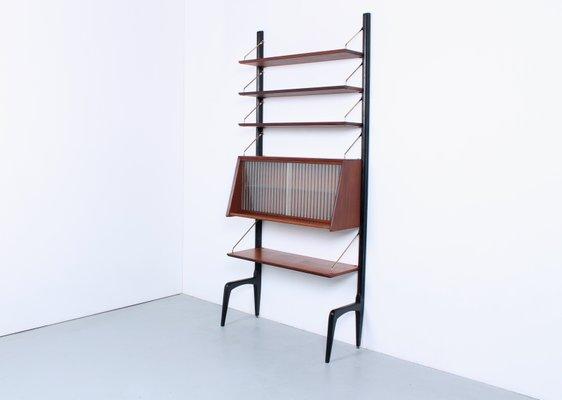 https://cdn20.pamono.com/p/g/2/8/281379_4krhi14430/libreria-modulare-in-teak-con-ante-in-vetro-di-louis-van-teeffelen-per-webe-anni-50-immagine-1.jpg
