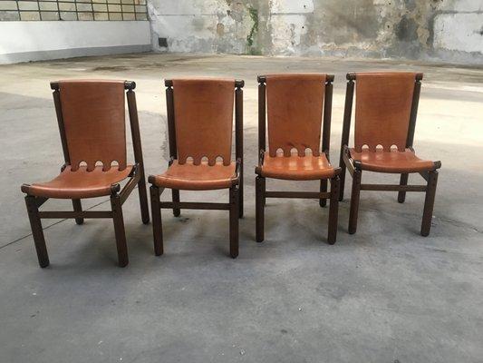 Sedie in legno e pelle color cognac di la permanente mobili cantù