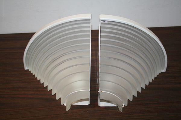 Applique ad angolo egisto di angelo mangiarotti per artemide 1985