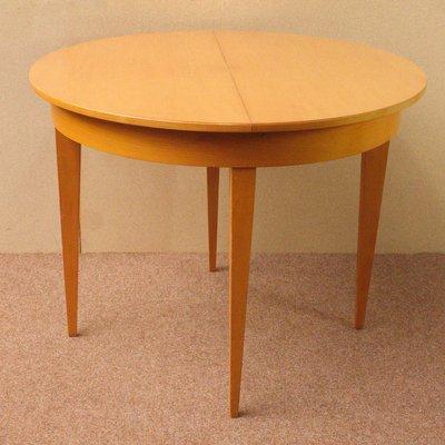https://cdn20.pamono.com/p/g/3/0/300473_5v5xzod9e6/tavolo-da-pranzo-rotondo-allungabile-in-legno-di-ciliegio-germania-anni-50-immagine-1.jpg
