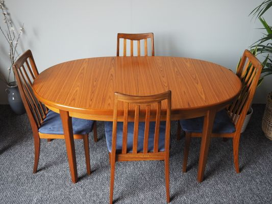 MidCentury Extending Dining Table Four Chairs By Ib KofodLarsen - Dining room table for four