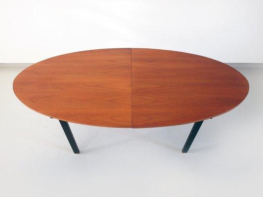Mesa de comedor extensible ovalada con tablero de teca y patas de ...