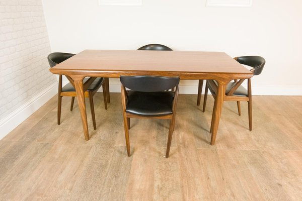 Tavolo da pranzo e quattro sedie di Johannes Andersen e Kai Kristiansen per  Uldum Møbelfabrik, anni \'60