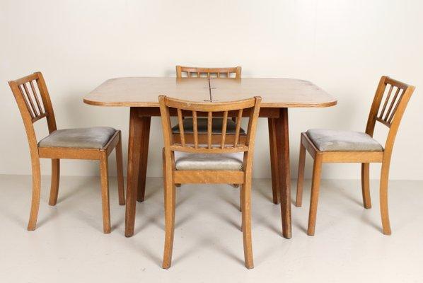 Mesa de comedor vintage de roble y cuatro sillas