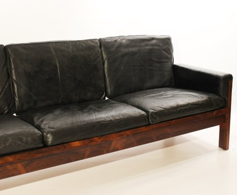 Danish Rosewood And Black Leather Sofa 1960s
