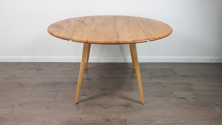 Mid Century British Drop Leaf Dining Table By Lucian Ercolani For Ercol 1960s