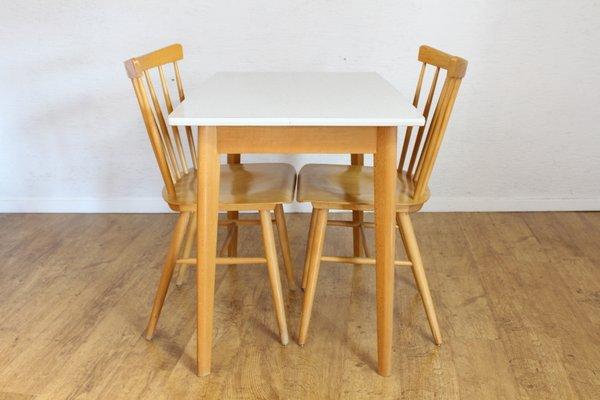 Juego de mesa de comedor y dos sillas escandinavo vintage, años 70