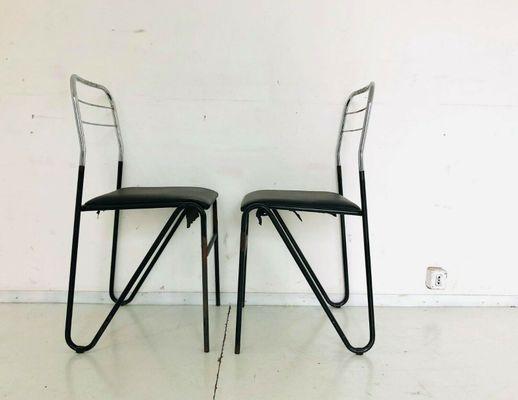 Sedie vintage in skai nero e metallo, anni \'70, set di 4