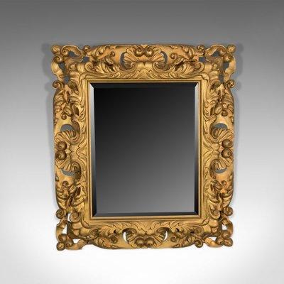 Specchio da parete vintage in legno dorato
