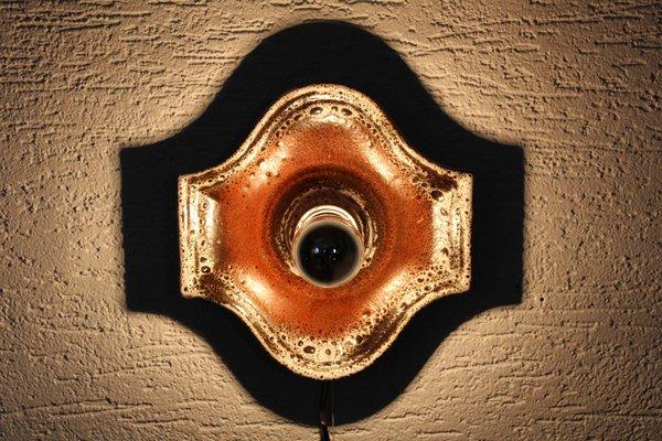 Applique con piatto in ceramica appliqué con foglie in ferro