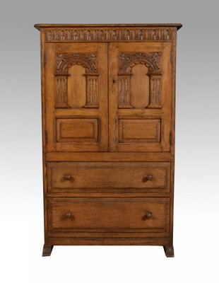 Mobiletto in legno di quercia massiccio intagliato, anni \'20