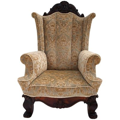 Large Antique Carved Walnut Winged Armchair For Sale At Pamono