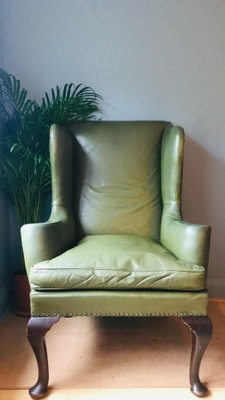 Groovy Antique Olive Green Leather Wingback Armchair Gmtry Best Dining Table And Chair Ideas Images Gmtryco