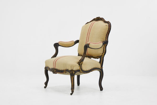 Large Antique French Upholstered Ebonized Wood Armchair For Sale