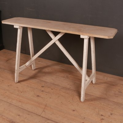 The Antique Trestle Table Is A Darker Wood With Turned Baer Legs And Delicate Bead Detail On Stretcher Perfectly Sized For