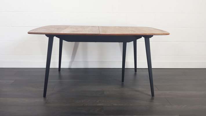 Mid Century Extendable Dining Table With Black Legs By Lucian Ercolani For Ercol 1960s