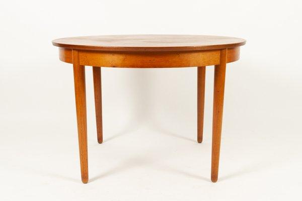 Mesa de comedor danesa vintage redonda extensible de teca y chapa, años 60