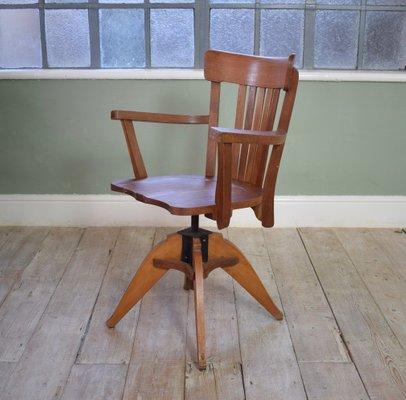Strange Mid Century Oak Captains Swivel Chair Bralicious Painted Fabric Chair Ideas Braliciousco