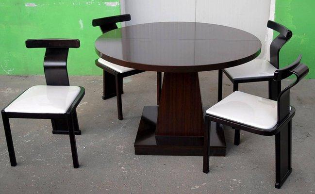 Mesa de comedor extensible redonda de palisandro, años 70