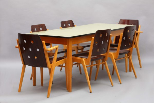 Model Maestro Stacking Chairs Dining Table By Franz Schuster 1950s Set Of 7 Bei Pamono Kaufen