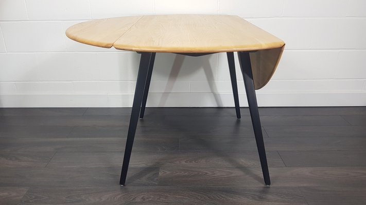 Black Leg Round Drop Leaf Dining Table By Lucian Ercolani For Ercol 1960s For Sale At Pamono