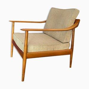 Skandinavischer Armlehnstuhl aus Holz, 1960er