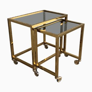 Italian Nesting Tables in Brass with Smoked Glass and Wheels, 1970s, Set of 2