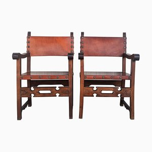 Geschnitzte spanische Sessel im Kolonialstil mit Leder, 19. Jh., 2er Set