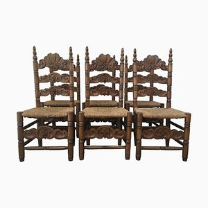 Geschnitzte und geschnitzte Holzstühle mit Strohsitz, 20. Jh., 6er Set