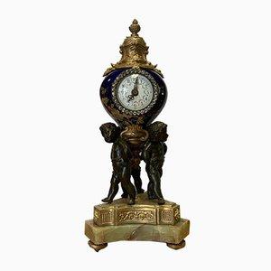 Bronze & Porcelain Clock with Putti