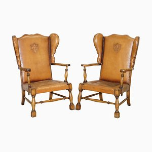 Edwardian Oak & Brown Leather Coat of Arms Armorial Crest Wingback Armchairs, Set of 2
