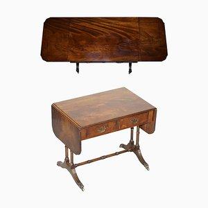 Großer ausziehbarer Beistell- oder Kartentisch aus geflammtem Hartholz mit Löwenfüßen von Bevan Funnell