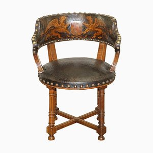 Antique Captains Chair with Embossed Leather Coat of Arms, 1880s