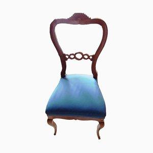 Blauer antiker Stuhl