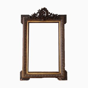 Verzierter Spiegel mit vergoldetem Rahmen