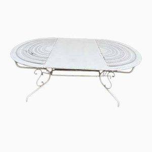 Mesa ovalada de hierro forjado